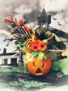 Learn how to create a flower arrangement for Halloween